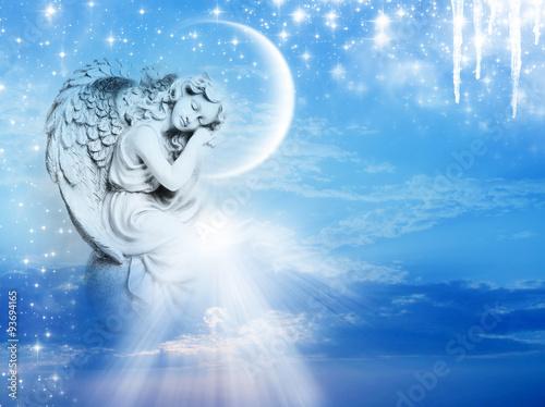 Fotografia, Obraz  an angel statue over mystical sky with divine light and stars