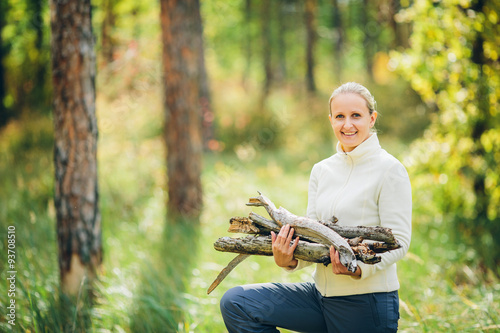 Stampe  woman gathering wood for a fire