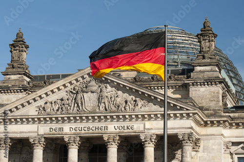 Photo  flag of the Federal Republic of Germany is waving in front of the national germa
