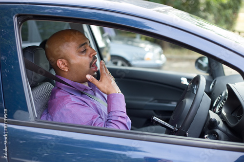 Photo  driver yawning in his car