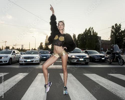 Stampa su Tela Beautiful and modern woman portrait posing on crosswalk