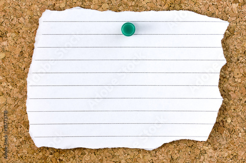 Fotografie, Obraz  Ripped blank white striped sheet on cork board with green small thumb tack