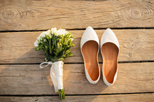 White Shoes And Wedding Bouquet
