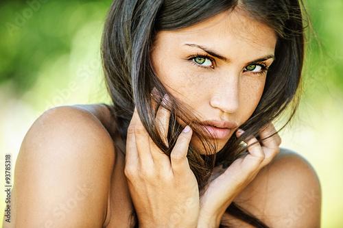 beautiful woman with bare shoulders sad looking at camera Canvas Print