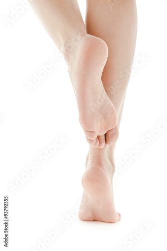 Fotografie, Obraz  Well groomed female feet, soles isolated on white background.