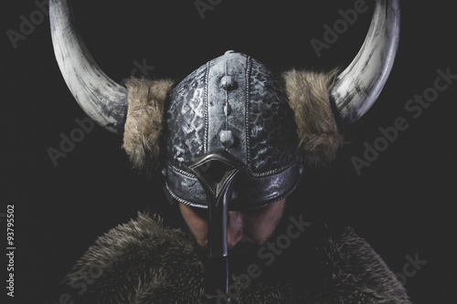 Obraz na plátně  Murderer, Viking warrior with iron sword and helmet with horns