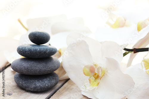 Foto op Canvas Zen Set of pebbles and orchid on wooden background