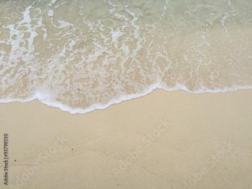 Stickers pour portes Eau Sea wave on the sandy beach
