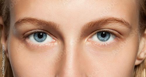 Valokuva  Closeup of blue eyes girl without makeup