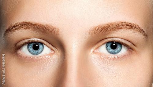 Valokuva  Closeup of blue eyes woman without makeup
