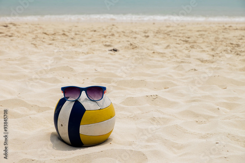 a Volleyball at the Summer Beach with a Sunglass Poster