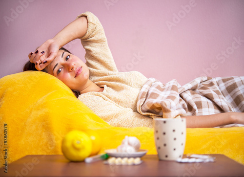 Fotografia  girl sick in bed under the covers