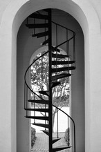 Black And White Photo Of Tall Metal Stairs In A Clock Tower Stairwell