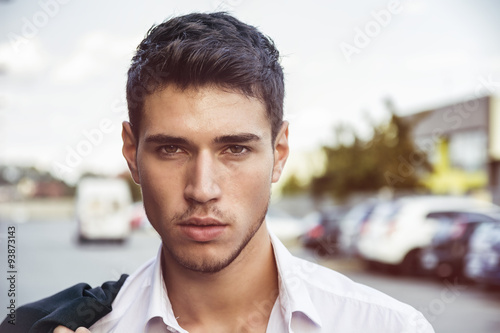 Attractive young man's headshot in urban environment