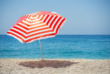 Striped Beach Umbrella On The ...