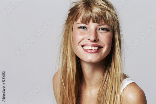 Lovely young woman smiling in studio