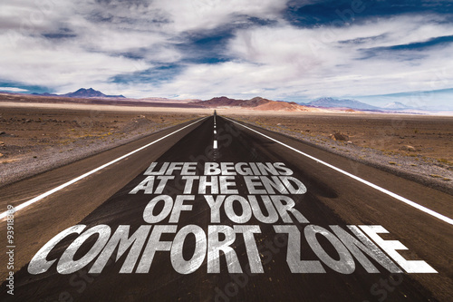 Photo  Life Begins at the End of your Comfort Zone written on desert road