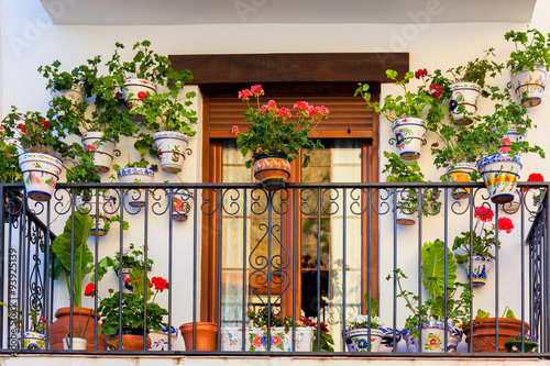 Fotografie, Obraz  Traditional European Balcony with colorful flowers and
