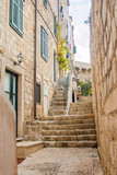 Fototapeta Na drzwi -      Narrow street and stairs in the Old Town in Dubrovnik, Croatia, Mediterranean ambient