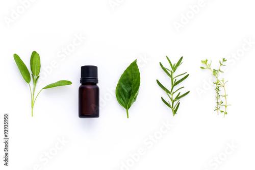 Fotografie, Obraz  Bottle of essential oil with herb holy basil leaf, rosemary,oreg