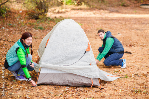 Fotografie, Obraz  couple pitching tent in countryside