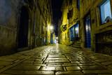Fototapeta Uliczki - Narrow street in night of old town of Rovinj, Croatia