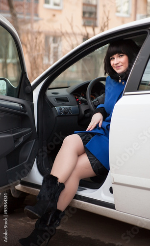 Fotobehang Snelle auto s girl in coat sitting in white car