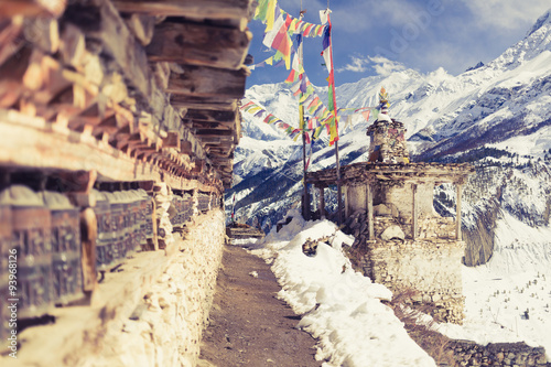 Montage in der Fensternische Nepal Prayer wheels in high Himalaya Mountains, Nepal village, tourism travel destination