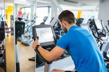 Fit Man Using The Exercise Bike