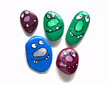 Five Smiling Faces Of Monsters. Painted Acrylic Pebbles.