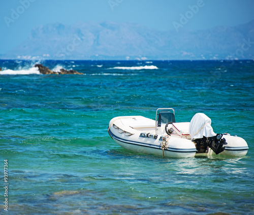 Spoed Foto op Canvas Eiland Inflatable motor boat on sea. Space for your text.