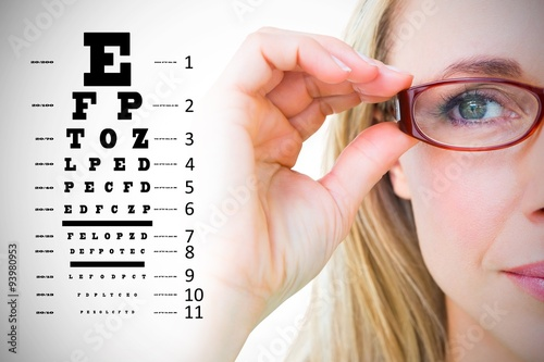 Fotografía  Composite image of pretty blonde with red reading glasses