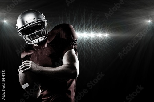 Composite image of american football player in looking away Tablou Canvas