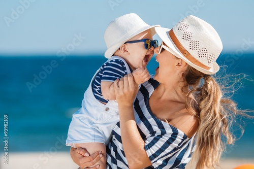 Fototapeta Young mother and her young son on the beach. obraz