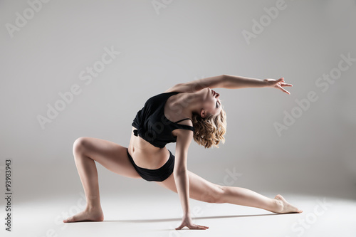 young beautiful woman in black T-shirt and shorts dancing Plakát