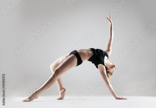 Door stickers Dance School young beautiful woman in black T-shirt and shorts dancing