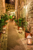 Fototapeta Alley - Beautiful decorated street in small town in Italy, Umbria