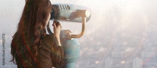 Fototapeta Girl with a telescope on the observation platform tourist obraz