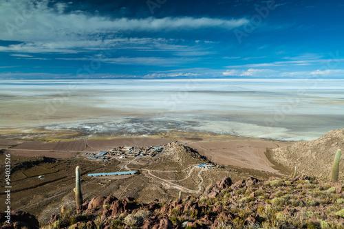 Fotografie, Obraz  Puerto Chuvica village, located by Salar de Uyuni salt plain in Bolivia