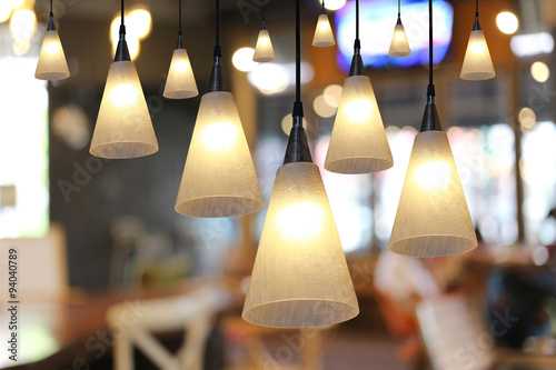 Fotografie, Obraz  Warm lighting modern ceiling lamps in the cafe.