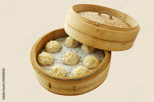 small steamer buns yumcha dim sum in bamboo steamer with chinese
