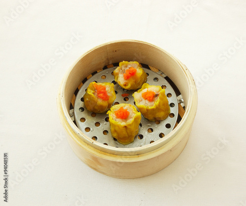 crab roe shao mai yumcha dim sum in bamboo steamer with chinese