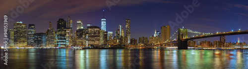 Obrazy wieloczęściowe Manhattan skyline at night, New York panoramic picture, USA