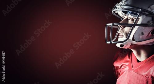 Fotografie, Tablou  Composite image of american footballer looking up