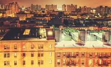 Retro Toned Harlem Neighborhood At Night, NYC, USA.