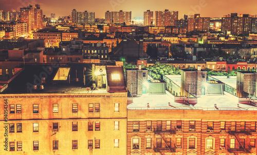 Fototapeten New York Retro toned Harlem neighborhood at night, NYC, USA.