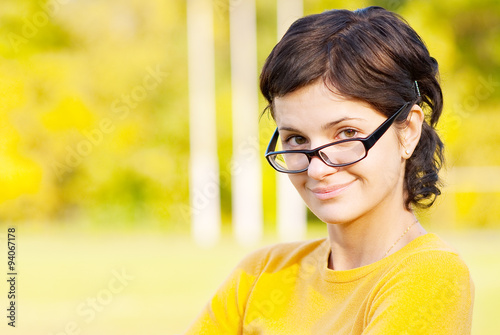 Fotografia, Obraz  Dark-haired girl in glasses