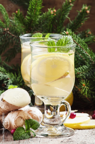 Staande foto Thee Hot ginger lemon tea in Christmas decoration with fir branches a