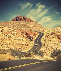Fototapeta Vintage Retro toned curved desert highway, travel adventure concept, USA