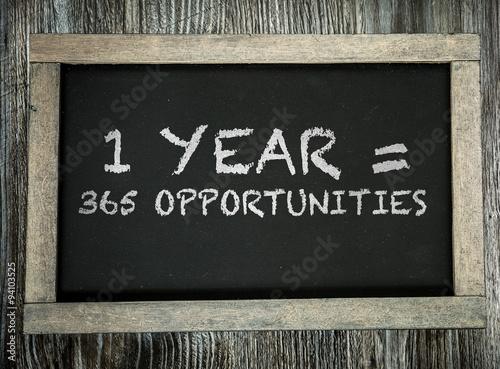 Fényképezés  1 Year = 365 Opportunities written on chalkboard